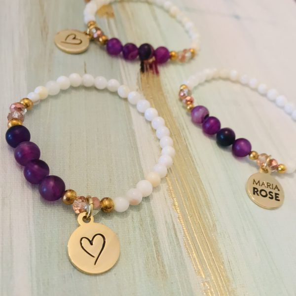 three purple amethyst beaded bracelets with Maria Rose gold logo charm