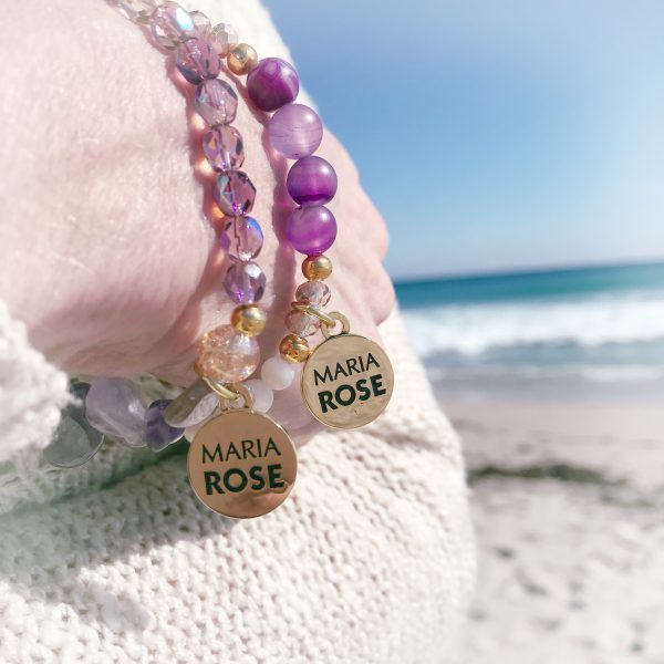 purple amethyst bracelet stack on female wrist with gold Maria Rose jewelry charm