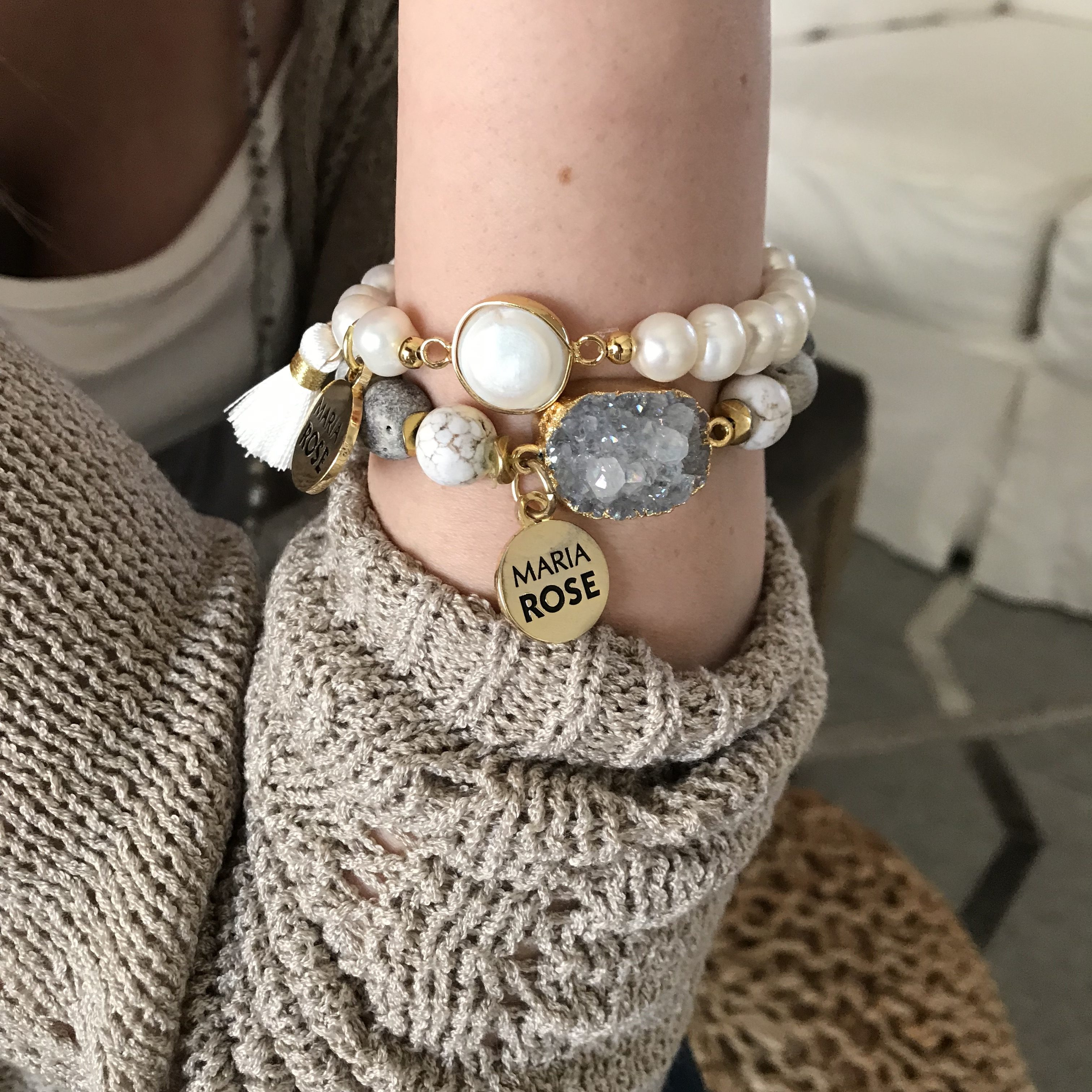 druzy bracelet with pearl bracelet stacked on female arm with gold Maria Rose charm